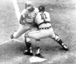 """FILE - Detroit Tigers catcher Bill Freehan puts the tag on Lou Brock of the St. Louis Cardinals at the plate in the fifth inning of fifth game of World Series at Detroit's Tiger Stadium,  in this Oct. 7, 1968 file photo. Freehan, an 11-time All-Star catcher with the Detroit Tigers and key player on the 1968 World Series championship team, has died at age 79. """"It's with a heavy heart that all of us with the Detroit Tigers extend our condolences to the friends and family of Bill Freehan,"""" the team said Thursday, Aug. 19, 2021. (AP Photo/File)"""