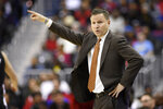 Washington Wizards coach Scott Brooks points during the second half of an NBA basketball game against the Milwaukee Bucks, Friday, Jan. 11, 2019, in Washington. The Wizards won 113-106. (AP Photo/Nick Wass)