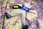 The Saint Louis mascot makes a confetti angel after Saint Louis defeated St. Bonaventure during an NCAA college basketball game in the Atlantic 10 men's tournament final Sunday, March 17, 2019, in New York. Saint Louis won 55-53. (AP Photo/Julio Cortez)