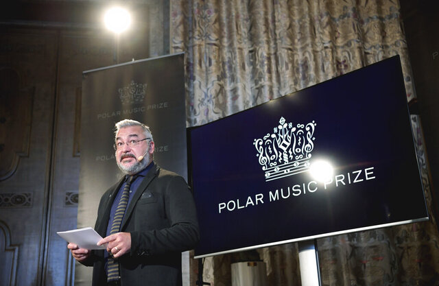 Chairman of the Polar Music Prize jury, Alfons Karabuda announces the 2020 Polar Music Prize winners are singer Anna Netrebkoze and song writer Dianne Warren, in Stockholm, Sweden, Tuesday Feb. 11, 2020.  American songwriter Diane Warren and Russian soprano Anna Netrebko are the winners of this year's Polar Music Prize. (Janerik Henriksson / TT via AP)