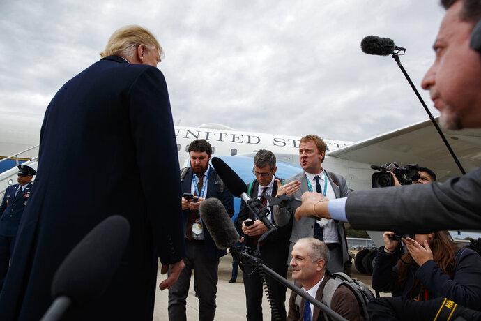 President Donald Trump listens to a question about the missing Saudi journalist Jamal Khashoggi after landing at Cincinnati Municipal Lunken Airport, Friday, Oct. 12, 2018, in Cincinnati, Ohio. (AP Photo/Evan Vucci)