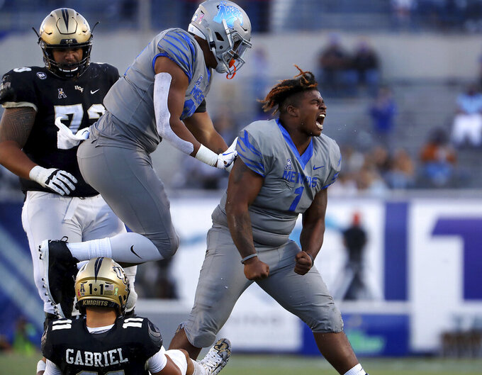Memphis defensive lineman O'Bryan Goodson (1) celebrates after sacking Central Florida quarterback Dillon Gabriel (11) during an NCAA college football game Saturday, Oct. 17, 2020, in Memphis, Tenn. (Patrick Lantrip/Daily Memphian via AP)