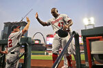 Washington Nationals' Howie Kendrick (47) is congratulated by bench coach Chip Hale after scoring during the second inning of the team's baseball game against the St. Louis Cardinals on Tuesday, Sept. 17, 2019, in St. Louis. (AP Photo/Jeff Roberson)