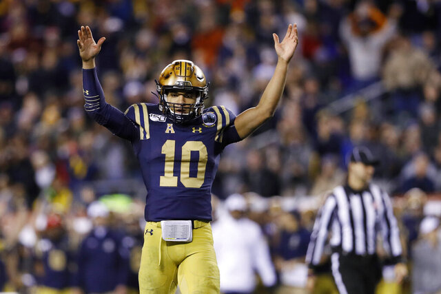 Navy's Malcolm Perry celebrates after a touchdown during the second half of an NCAA college football game against Army, Saturday, Dec. 14, 2019, in Philadelphia. (AP Photo/Matt Slocum)