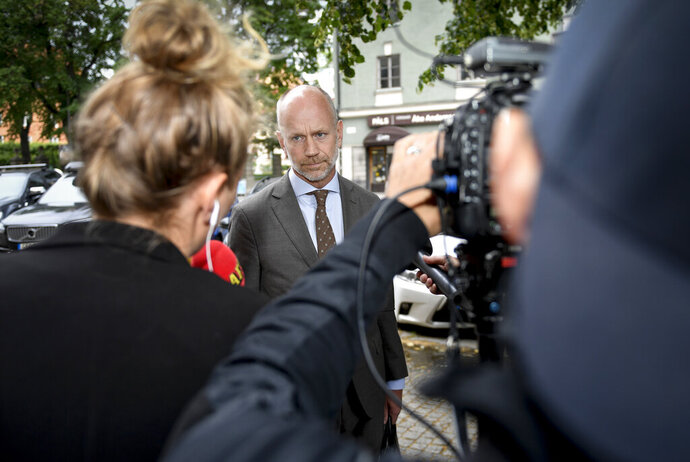 Lawyer Henrik Olsson Lilja faces the media following the court decision against American hip hop star Asap Rocky, the stage name of Rakim Mayers, at the Stockholm District Court in Sweden, Friday July 5, 2019. U.S. rapper A$AP Rocky was ordered held by a Swedish court Friday for two weeks in pre-trial detention while police investigate a fight on Sunday in central Stockholm. (Stina Stjernkvist / TT via AP)