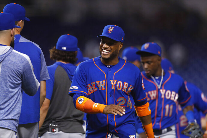 New York Mets' Robinson Cano (24) celebrates with teammates after a baseball game against the Miami Marlins, Saturday, July 13, 2019, in Miami. (AP Photo/Brynn Anderson)