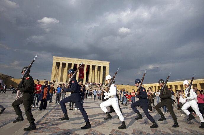 Soldiers march during a changing of guard ceremony as thousands of people visit the mausoleum of Mustafa Kemal Ataturk, the founder of modern Turkey, to pay respect on the day marking the 100th anniversary of the start of Turkey's War of Independence under the leadership of young Ottoman army general, Mustafa Kemal (Ataturk), 38, in Ankara, Turkey, Sunday, May 19, 2019.(AP Photo/Burhan Ozbilici)
