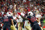 San Francisco 49ers quarterback Jimmy Garoppolo (10) gets the throw off as Arizona Cardinals outside linebacker Terrell Suggs (56) applies pressure during the first half of an NFL football game, Thursday, Oct. 31, 2019, in Glendale, Ariz. (AP Photo/Ross D. Franklin)