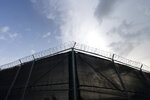 In this photo reviewed by U.S. military officials, a fence is seen at Camp Justice, Sunday, Aug. 29, 2021, in Guantanamo Bay Naval Base, Cuba. Camp Justice is where the military commission proceedings are held for detainees charged with war crimes. (AP Photo/Alex Brandon)