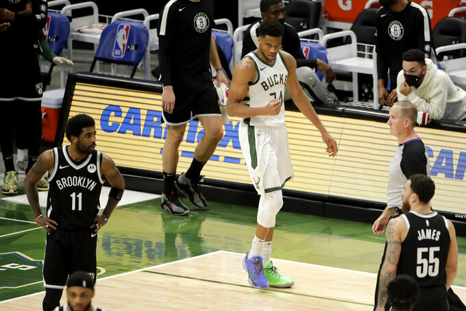 Milwaukee Bucks' Giannis Antetokounmpo pumps his fist after making a shot during the second half of an NBA basketball game against the Brooklyn Nets Tuesday, May 4, 2021, in Milwaukee. (AP Photo/Aaron Gash)