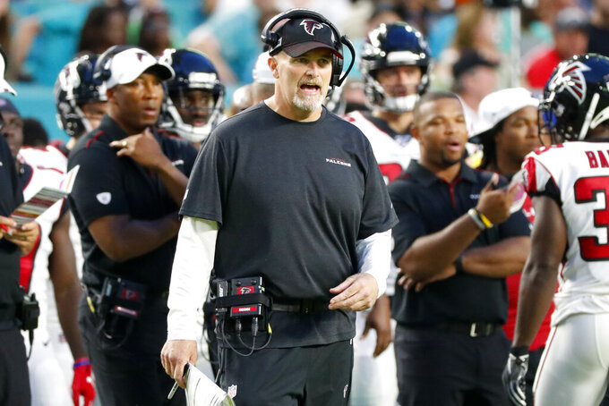 Atlanta Falcons coach Dan Quinn watches during the first half of the team's preseason NFL football game against the Miami Dolphins, Thursday, Aug. 8, 2019, in Miami Gardens, Fla. (AP Photo/Wilfredo Lee)