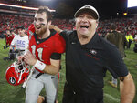 FILE - In this Nov. 23, 2019, file photo, Georgia head coach Kirby Smart and quarterback Jake Fromm celebrate beating Texas A&M 19-13 in an NCAA college football game, in Athens, Ga. Heading into this year's slate of conference title games a case could be made that No. 1 LSU (No. 2 CFP), No. 2 Ohio State (No. 1 CFP) and No. 3 Clemson (No. 3 CFP) have all done enough already to lose their conference championship games and still get in the College Football Playoff. (Curtis Compton/Atlanta Journal-Constitution via AP, File)