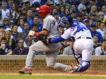 St. Louis Cardinals' Paul Goldschmidt (46) is tagged out at home by Chicago Cubs catcher Willson Contreras (40) during the sixth inning of a baseball game Sunday, June 9, 2019, in Chicago. (AP Photo/Matt Marton)