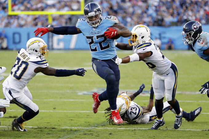 Tennessee Titans running back Derrick Henry (22) scores a touchdown on an 11-yard run against the Los Angeles Chargers in the second half of an NFL football game Sunday, Oct. 20, 2019, in Nashville, Tenn. (AP Photo/James Kenney)