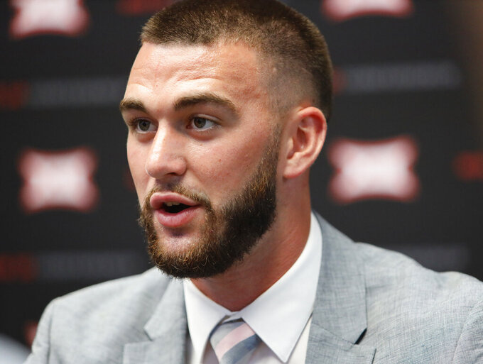 FILE - In this July 16, 2019, file photo, Kansas State quarterback Skylar Thompson speaks during Big 12 Conference NCAA college football media day in Arlington, Texas. There is no question whether Thompson will be under center when the Wildcats open the season against Nicholls State. Nor is there any doubt he'll be there the rest of the year. (AP Photo/David Kent, File)