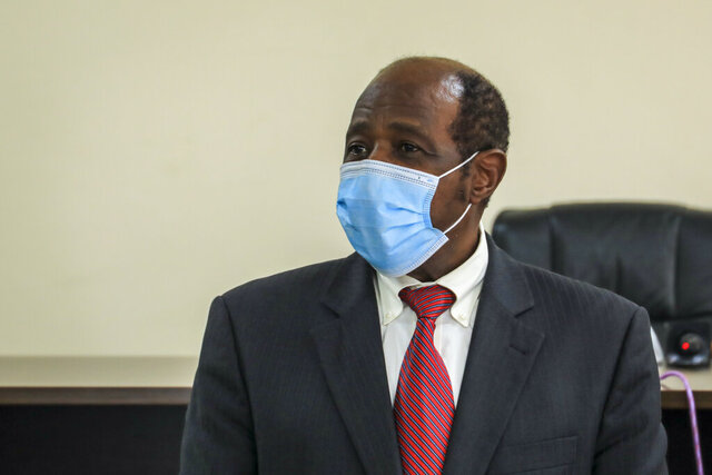 FILE - In this Monday, Aug. 31, 2020 file photo, Paul Rusesabagina appears in front of the media at the headquarters of the Rwanda Bureau of Investigations building in Kigali, Rwanda. Rusesabagina, who inspired the film