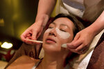 Emma Nowakowski, right, from Chuan Spa at The Langham, in Chicago, demonstrates a Jade Stone Eye Rescue Treatment, during the annual International Spa Association event, in New York, Tuesday, Aug. 7, 2018. (AP Photo/Richard Drew)