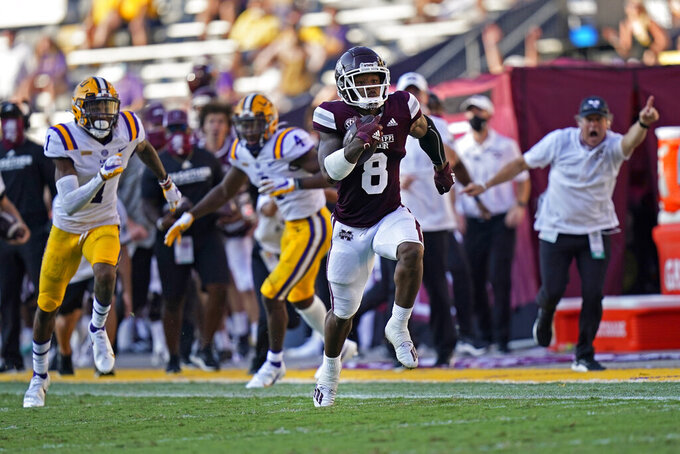 Mississippi State running back Kylin Hill (8) runs to the end zone for a touchdown against LSU cornerback Eli Ricks (1) and safety Todd Harris Jr. (4) on a pass reception in the second half an NCAA college football game in Baton Rouge, La., Saturday, Sept. 26, 2020. Mississippi State won 44-34. (AP Photo/Gerald Herbert)