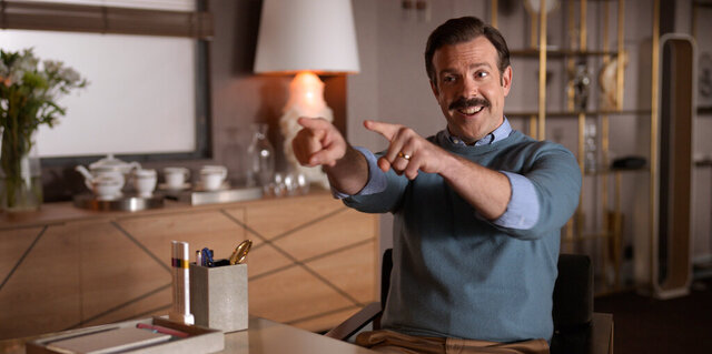 "This image released by Apple TV Plus shows Jason Sudeikis in ""Ted Lasso,"" premiering globally on Friday, August 14, on Apple TV Plus. (Apple TV Plus via AP)"