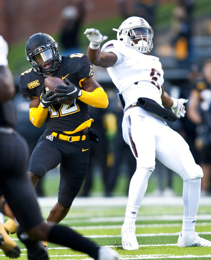 Appalachian State defensive back Steven Jones steps in front of Troy wide receiver Khalil McClain to intercept a pass in the first half of an NCAA college football game Saturday, Nov. 28, 2020, in Boone, N.C. (Walt Unks/The Winston-Salem Journal via AP)
