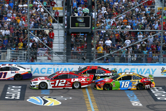Ryan Blaney (12), Kyle Busch (18), Martin Truex Jr. (19) and Denny Hamlin (11) during the NASCAR Cup Series auto race at ISM Raceway, Sunday, Nov. 10, 2019, in Avondale, Ariz. (AP Photo/Ralph Freso)