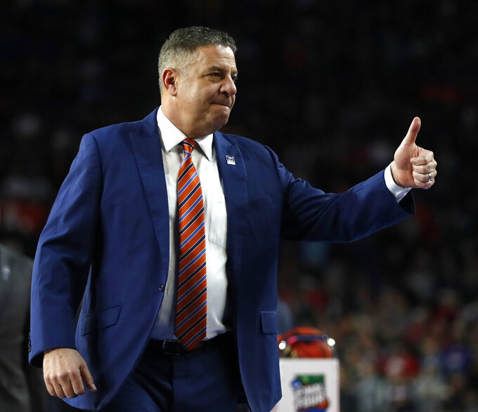 Auburn head coach Bruce Pearl reacts to fans before a semifinal round game against Virginia in the Final Four NCAA college basketball tournament, Saturday, April 6, 2019, in Minneapolis. (AP Photo/Jeff Roberson)
