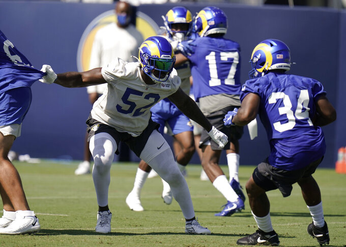 FILE - In this Aug. 27, 2020, file photo, Los Angeles Rams linebacker Terrell Lewis (52) defends against running back Malcolm Brown (34) during NFL football training camp in Thousand Oaks, Calif. Lewis will miss at least the first three weeks of his rookie season with the Rams due to a right knee problem that isn't as serious as Los Angeles first feared. Lewis will start the season on the non-football injury list, Rams coach Sean McVay said Wednesday, Sept. 9, as they began practice to face the Dallas Cowboys on Sunday night in SoFi Stadium's inaugural game. (AP Photo/Jae C. Hong, File)
