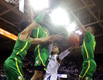 Washington guard David Crisp, second from right, is blocked by Oregon forward Kenny Wooten, second from left, Will Richardson, left, and Louis King, right, during the first half of an NCAA college basketball game, Saturday, March 9, 2019, in Seattle. (AP Photo/Ted S. Warren)