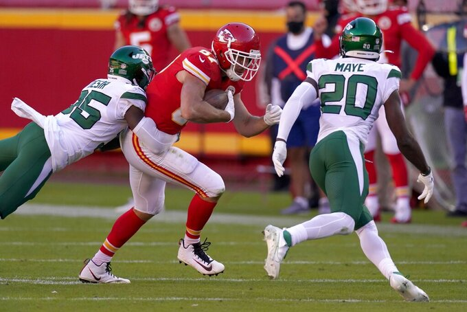 New York Jets' Pierre Desir (35) and Marcus Maye (20) combine to stop Kansas City Chiefs tight end Travis Kelce (87) from gaining more yardage after catching a pass in the second half of an NFL football game on Sunday, Nov. 1, 2020, in Kansas City, Mo. (AP Photo/Charlie Riedel)