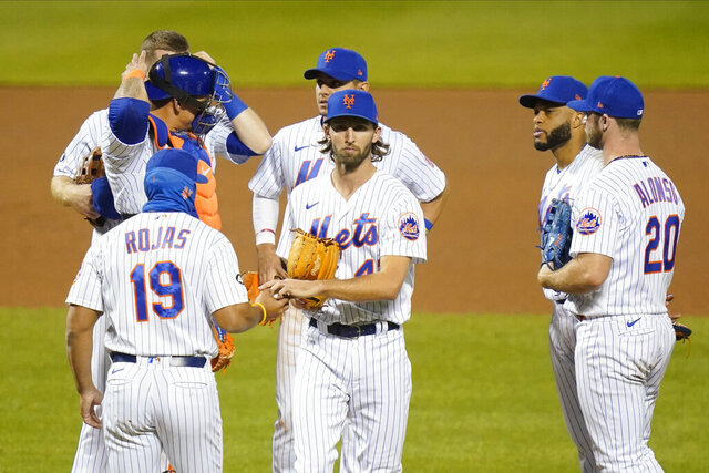 New York Mets relief pitcher Chasen Shreve (47) hands the ball to manager Luis Rojas (19) as he leaves the game during the eighth inning of a baseball game against the Tampa Bay Rays Wednesday, Sept. 23, 2020, in New York. (AP Photo/Frank Franklin II)