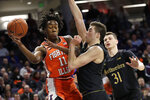 Illinois guard Ayo Dosunmu, left, passes the ball as Northwestern center Ryan Young, center, and forward Robbie Beran defend during the first half of an NCAA college basketball game in Evanston, Ill., Thursday, Feb. 27, 2020. (AP Photo/Nam Y. Huh)