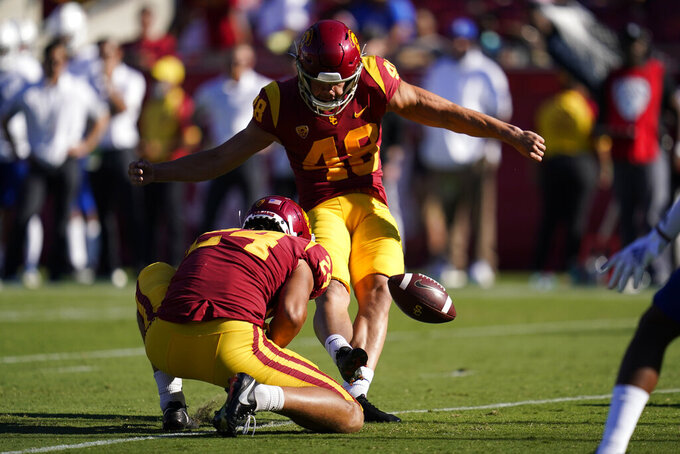 Southern California place kicker Parker Lewis (48) kicks an extra point after a touchdown during the second half of an NCAA college football game against San Jose State Saturday, Sept. 4, 2021, in Los Angeles. (AP Photo/Ashley Landis)