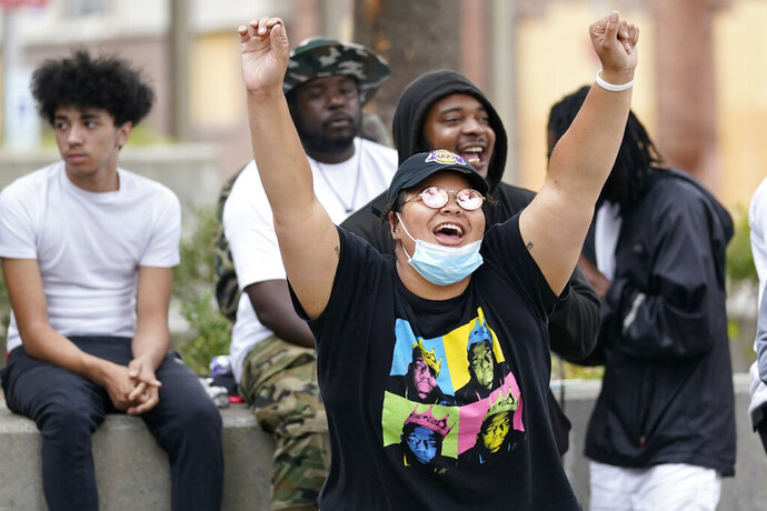 People dance in Jefferson square, Friday, Sept. 25, 2020, in Louisville. Breonna Taylor's family demanded Friday that Kentucky authorities release all body camera footage, police files and the transcripts of the grand jury hearings that led to no charges against police officers who killed the Black woman during a March drug raid at her apartment. (AP Photo/Darron Cummings)