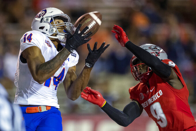 Houston Baptist wide receiver Vernon Harrell (14) tries for a reception as New Mexico safety Jerrick Reed (9) defends during the second half of an NCAA college football game Thursday, Sept. 2, 2021, in Albuquerque, N.M. The pass was incomplete. (AP Photo/Andres Leighton)