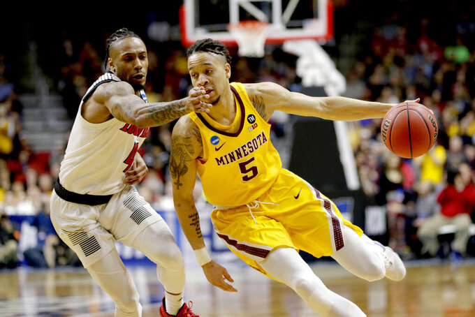 Minnesota's Amir Coffey (5) drives around Louisville's Khwan Fore (4) during the second half of a first round men's college basketball game in the NCAA Tournament, in Des Moines, Iowa, Thursday, March 21, 2019. (AP Photo/Nati Harnik)