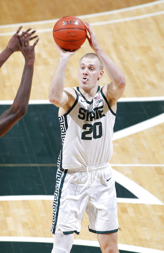 Michigan State's Joey Hauser shoots against Western Michigan during the second half of an NCAA college basketball game, Sunday, Dec. 6, 2020, in East Lansing, Mich. Michigan State won 79-61. (AP Photo/Al Goldis)