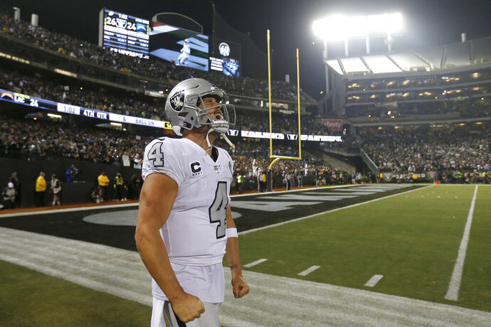 Oakland Raiders quarterback Derek Carr (4) celebrates after the Raiders defeated the Los Angeles Chargers 26-24 in an NFL football game in Oakland, Calif., Thursday, Nov. 7, 2019. (AP Photo/D. Ross Cameron)