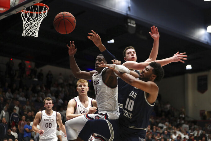 Saint Mary's forward Malik Fitts (24) battles for a rebound against Utah State forward Alphonso Anderson (10) during the second half of an NCAA college basketball game in Moraga, Calif., Friday, Nov. 29, 2019. (AP Photo/Jed Jacobsohn)