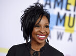 FILE - In this Oct. 9, 2018, file photo, Gladys Knight arrives at the American Music Awards in Los Angeles. Big-name entertainers believe social injustice needs to be addressed during the Super Bowl and are ensuring the topic that ignited a political firestorm that engulfed the NFL will be in the spotlight. They passionately disagree on how. Some will perform in Super Bowl-related events while others will be noticeably absent.  (Photo by Jordan Strauss/Invision/AP, File)