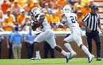 UTEP defensive end Praise Amaewhule (23) runs after recovering a fumble as he's trailed by defensive back Kahani Smith (24) in the first half of an NCAA college football game against Tennessee, Saturday, Sept. 15, 2018, in Knoxville, Tenn. (AP Photo/Wade Payne)