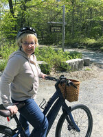 In this June 8, 2019 photo, Janice Goodwin stops her electric-assist bicycle gate near a carriage path in Acadia National Park at Bar Harbor, Maine. Electric-assist bikes are allowed on paved roads but are banned on carriage path and bicycle paths in national parks. (AP Photo/David Sharp)