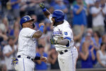 Kansas City Royals' Hanser Alberto, right, celebrates with Salvador Perez after hitting a two-run home run during the third inning of a baseball game against the Minnesota Twins Friday, July 2, 2021, in Kansas City, Mo. (AP Photo/Charlie Riedel)