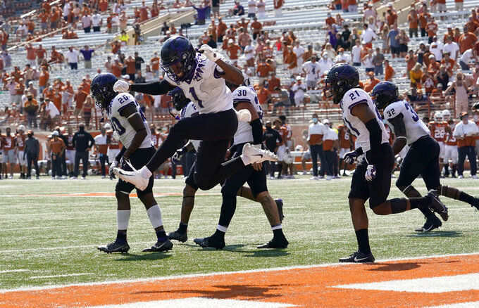 TCU cornerback Tre'Vius Hodges-Tomlinson (1) celebrates with teammates after TCU recovered a Texas fumble during the second half of an NCAA college football game, Saturday, Oct. 3, 2020, in Austin, Texas. (AP Photo/Eric Gay)