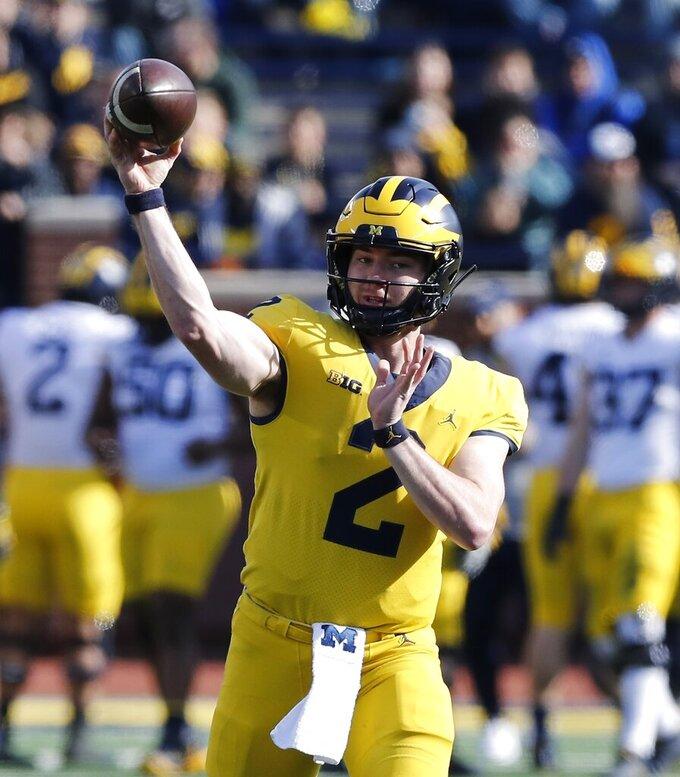 Michigan quarterback Shea Patterson throws during the team's annual spring NCAA college football game, Saturday, April 13, 2019, in Ann Arbor, Mich. (AP Photo/Carlos Osorio)