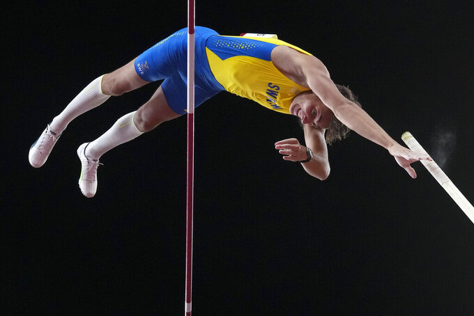 Armand Duplantis, of Sweden, competes in the men's pole vault final at the 2020 Summer Olympics, Tuesday, Aug. 3, 2021, in Tokyo. (AP Photo/Matthias Schrader)
