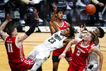 Purdue guard Jaden Ivey (23) is fouled as he tries to shoot between Wisconsin's Micah Potter (11), Aleem Ford (2) and Tyler Wahl (5) during the second half of an NCAA college basketball game in West Lafayette, Ind., Tuesday, March 2, 2021. (AP Photo/Michael Conroy)