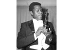 FILE - Actor Sidney Poitier appears with his Oscar for best actor, for his role in