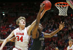 Washington forward Noah Dickerson (15) and Utah center Jayce Johnson (34) battle for a rebound during the first half of an NCAA college basketball game Thursday, Jan., 10, 2019, in Salt Lake City. (AP Photo/Rick Bowmer)