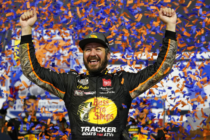 FILE - In this Sept. 11, 2021, file photo, Martin Truex Jr., celebrates winning the NASCAR Cup series auto race in Richmond, Va. Truex is in third place in the NASCAR playoff standings heading into Sunday's race at Fort Worth, Texas.  (AP Photo/Steve Helber, File)