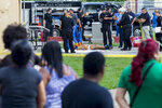 EDS NOTE: GRAPHIC CONTENT - Police investigators work the scene of a multiple killing in San Juan, Puerto Rico, Tuesday, Oct. 15, 2019. Several people are reported dead following a shooting in the Rio Piedras neighborhood of San Juan. (AP Photo/Dennis M. Rivera Pichardo)